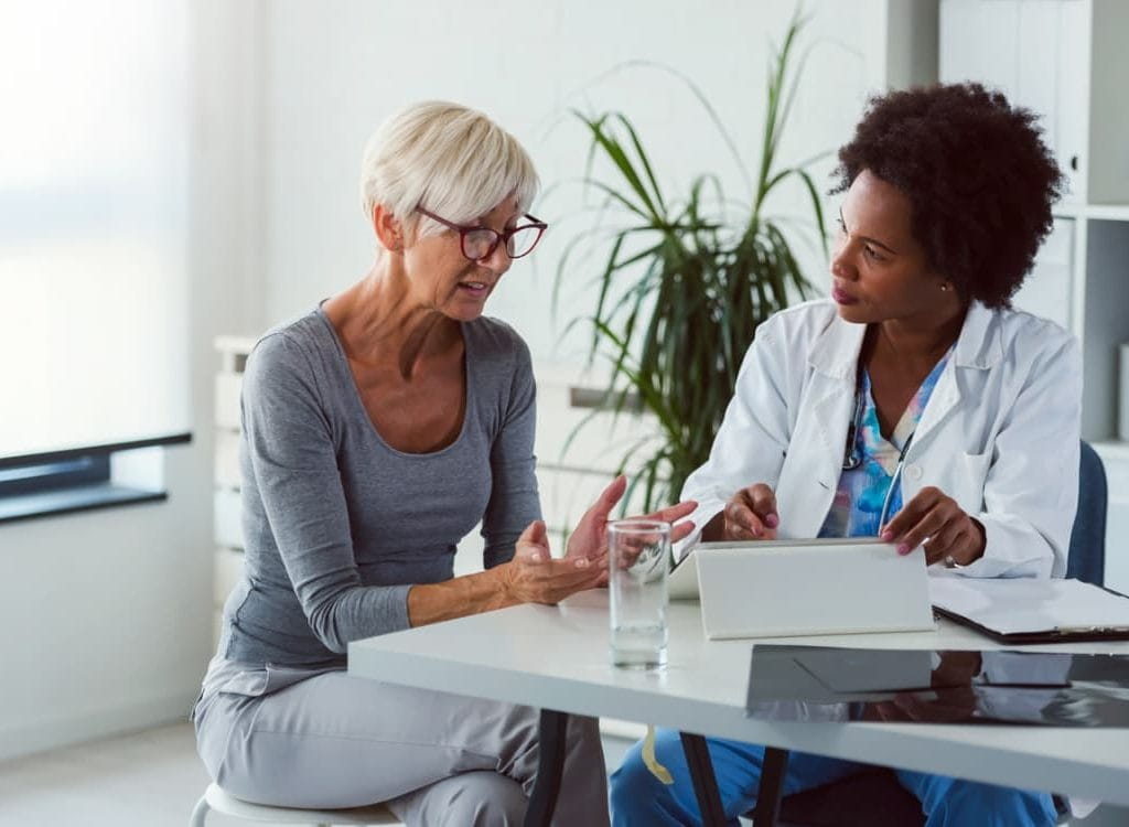 Patient And Physician Discuss Palliative Care